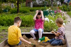 Children in sand-box Stock Images