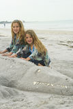 Children with sandy gator Royalty Free Stock Images