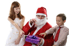 Children and Santa. Wish to take a New Year's gift Stock Photos