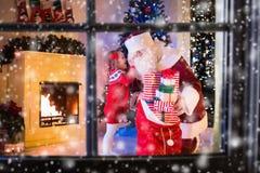 Kids and Santa opening Christmas presents Stock Image