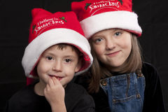 Children in Santa Claus hats Royalty Free Stock Photos