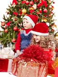 Children in Santa hat with gift box. Stock Images