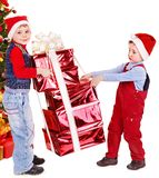 Children in Santa hat with gift box . Royalty Free Stock Photo