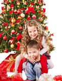 Children in Santa hat with gift box . Stock Photography