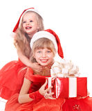 Children in santa hat holding gift box. Royalty Free Stock Photo