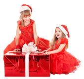 Children in santa hat holding gift box. Royalty Free Stock Image