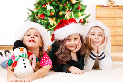 Children in Santa hats Royalty Free Stock Image