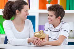 Children saving money Stock Photos