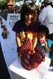 Children saving up money Royalty Free Stock Photography