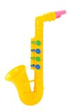 Children saxophone. Made of colored plastic against white background Royalty Free Stock Image