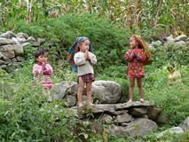 Children saying Namaste Stock Photo