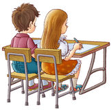 Children at school. The boy and the girl at school sit at a school desk Royalty Free Stock Photo
