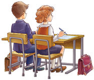 Children at school. Sit at a school desk Royalty Free Stock Photos