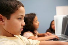 Children At School. Children on computers at school Stock Images