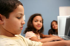Children At School. Children on computers at school Royalty Free Stock Photos