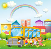 Children and school bus in the park Royalty Free Stock Photos