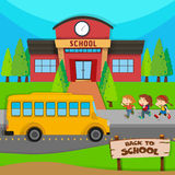 Children and school bus at school Royalty Free Stock Photos