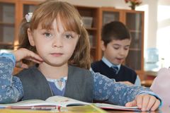Children at school in classroom Stock Images