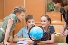 Children at school in lessons. Children with teacher at school in lessons stock photos