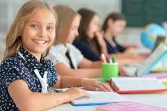 Children at school in lessons. Children at school sit in the classroom royalty free stock photo