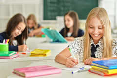 Children at school in lessons. Children at school sit in the classroom stock photography
