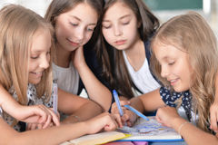 Children at school in lessons. Children at school sit in the classroom royalty free stock images