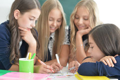 Children at school in lessons. Children at school sit in the classroom royalty free stock image
