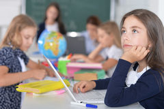 Children at school in lessons. Children at school sit in the classroom stock image