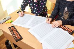 Children at school, mental arithmetic stock photos