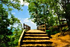 Stairway to heaven with bridge overlooking mountain view royalty free stock image