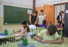 Children at school with teacher Stock Images