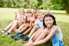 Children in school trip. Multicultural children in school trip to nature wave happy Stock Photography