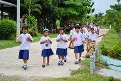Children in school uniform. Thai school children in uniform walking in line to school Stock Photo