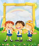 Children in school uniform standing on the park Royalty Free Stock Photo