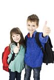 Children, schoolboy and schoolgirl showing OK sign Stock Images