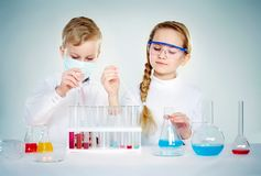 Children scientists. Two children making chemical experiments Royalty Free Stock Photos