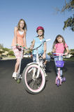 Children With Scooters And Bicycle Stock Photo