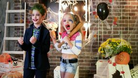 Children screaming, harley quinn and joker costumes, crazy characters, kids having fun at halloween stock footage