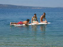Children in sea fun. Romance boy and girls on blue Adriatic sea (Croatia- Dalmatia Royalty Free Stock Images