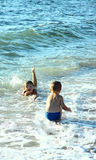 Children and sea. Children: the girl and the boy swim in the sea. Bright, summer day Stock Photos