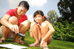 Children searching for clues Stock Image