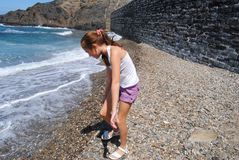 Children searching stones in a beach of Collioure, Colliure, small french village with a fortress in a sunny day of summer. royalty free stock images