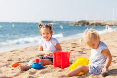 Children at the seaside playing Stock Photos