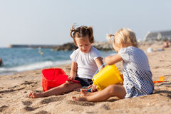 Children at the seaside playing Stock Photo