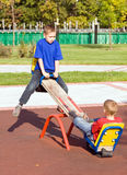 Children on a seesaw stock images