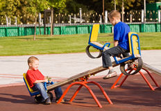 Children on a seesaw Royalty Free Stock Images
