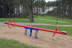 Children seesaw in park Stock Photography