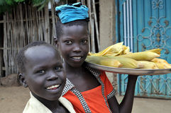 Children selling corn. TEREKEKA, JUNE 11: Unidentified children selling cooked corn in Terekeka, South Sudan, on June 11, 2011. World Day Against Child Labour royalty free stock photography