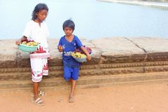 Children selling flowers Angkor Wat temple, Cambodia Royalty Free Stock Photos