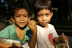Children selling postcards Stock Photo